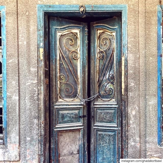 Knocked out horseshoeforluck ..... bluedoor old vintage worndown ... (Beirut, Lebanon)