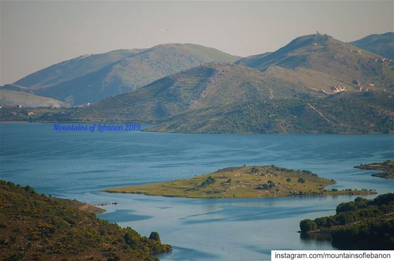 Just an island in a blue lake surrounded by green hills ... roadtrip ... (Qaraaoun, Béqaa, Lebanon)