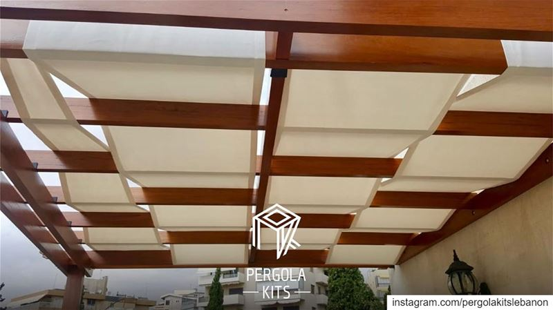 Iroko Wood, Attached Pergola with Fabric Roofing. PergolaKitsLebanon in... (Hazmieh)
