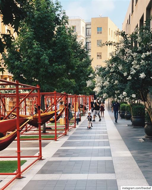 """Red hammocks and red swings have been taking over Fakhry Bey street in... (Beirut Souks)"