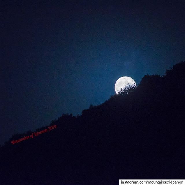 Full moon playing hide and seek behind the hills nahreljoz ........ (Naher El jouz)
