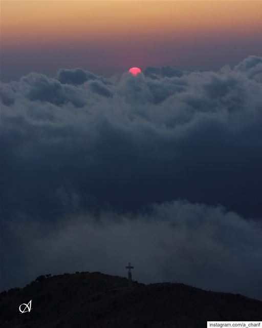 My view of sunset today sunset sun sky cloud mist hill cross view... (Jezzîne, Al Janub, Lebanon)
