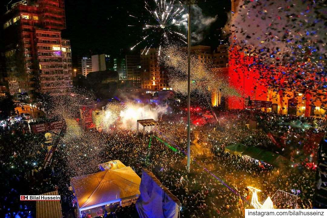 Thousands of anti-government protesters and citizens watch a firework...