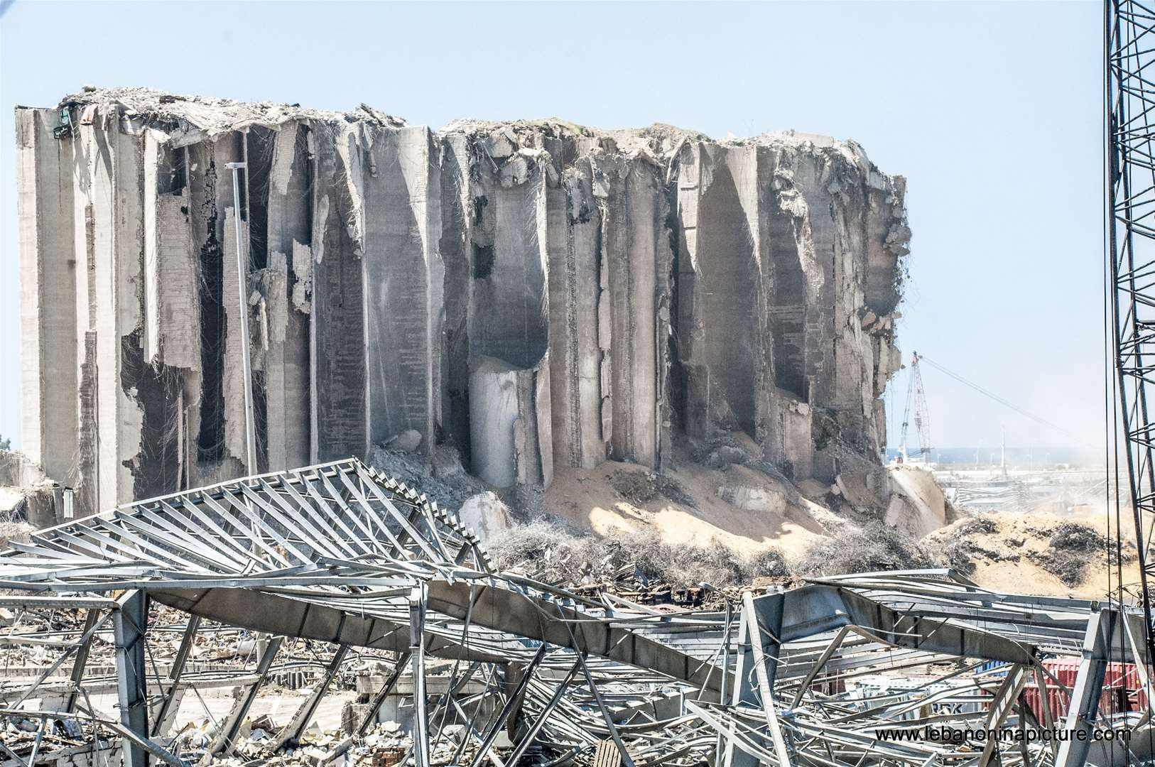 The still standing wheat storage and the explosion area in Beirut Port