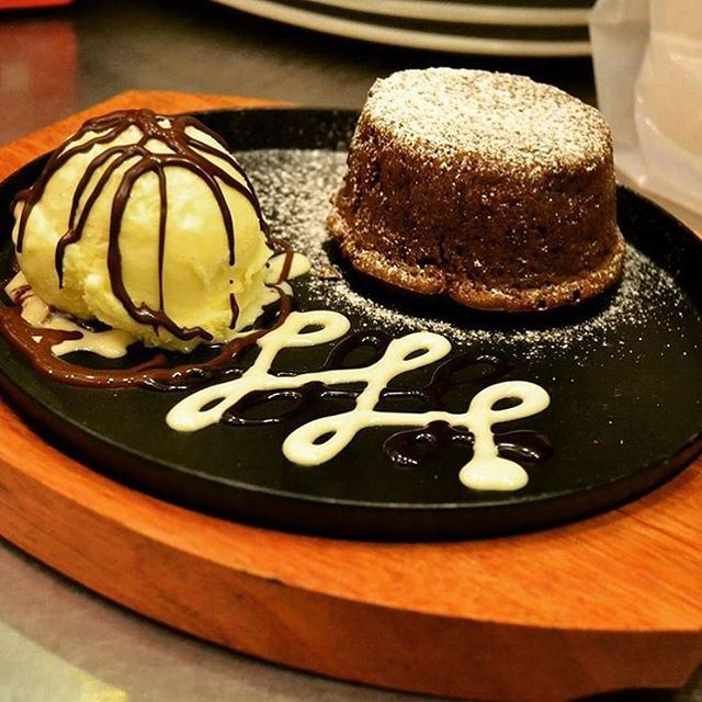 I didn't hear the question, but the answer is Chocolate Foundan with ice cream @chocolate_bar_hamra (Chocolate Bar)
