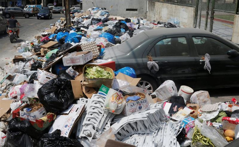 Piles of Garbage Blocking a Car in Dekwaneh