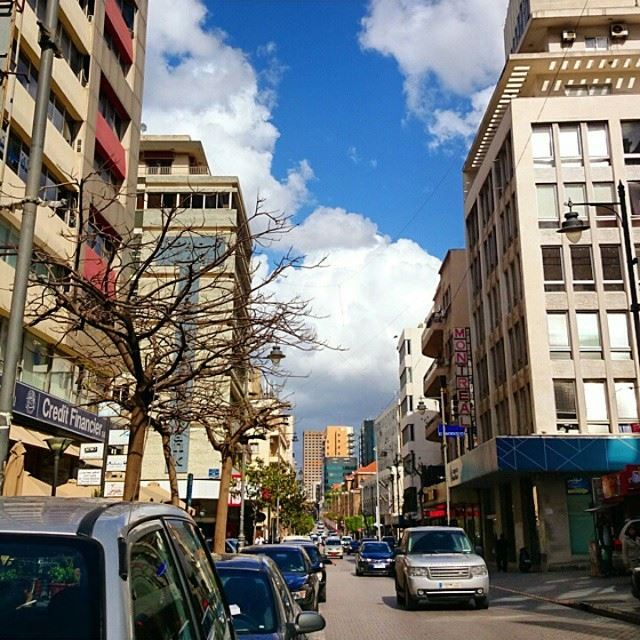Hamra street in Beirut on a sunny cloudy day.