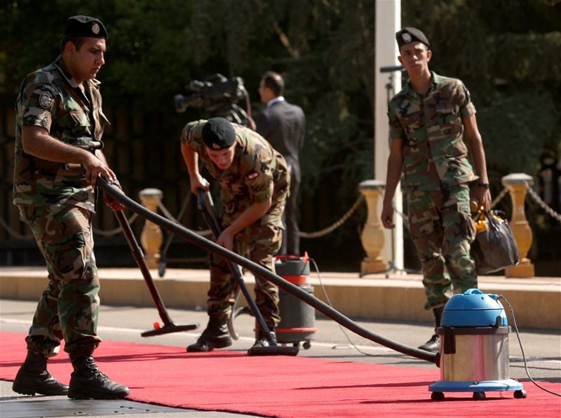 Soldiers Grooming the Red Carpet Prior to the President Arrival