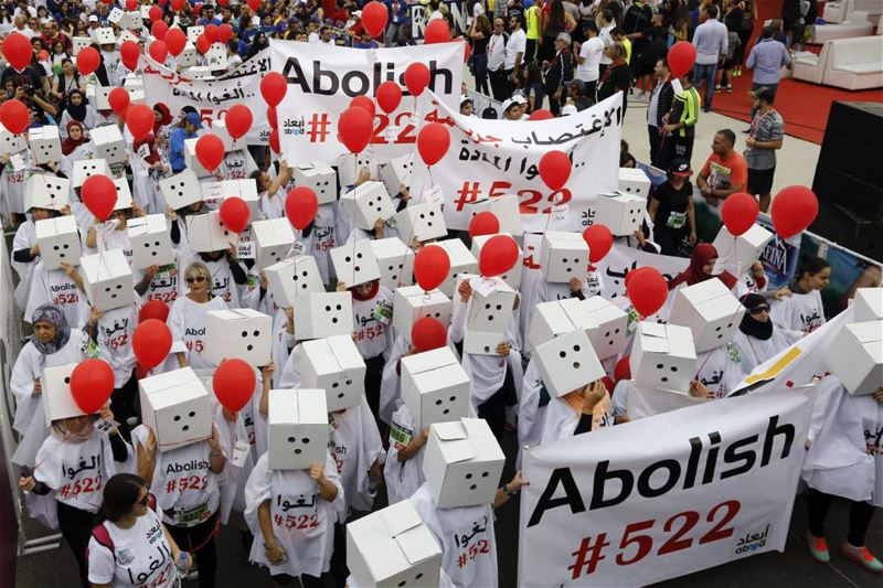 Participants, demanding the abolishment of article 522 of Lebanon's Penal code, during Beirut Marathon