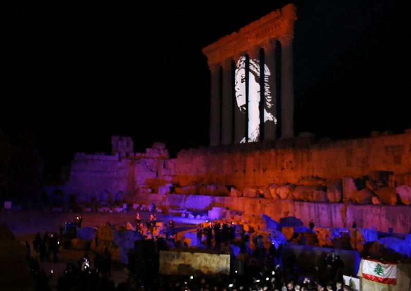 The temples of Baalbek, a UNESCO world heritage site in Lebanon's eastern Bekaa Valley, are illuminated with a portrait of celebrated Lebanese singer Fayrouz as part of an event to celebrate the singer's 81th birthday.