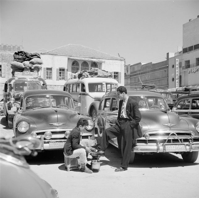 Young Shoeshiner at a Beirut Bus Station  1950