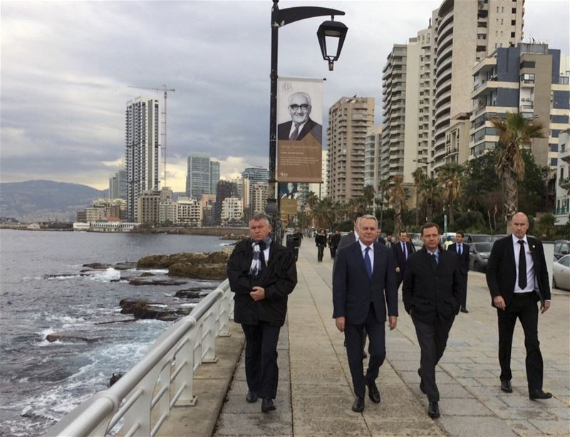 French Foreign Minister Jean-Marc Ayrault, French Ambassador Emmanuel Bonne, walking in Beirut waterfront promenade.