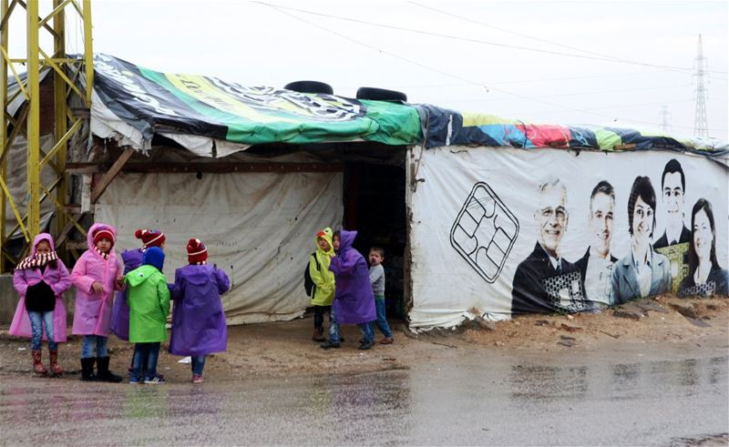 Syrian refugee children play near a tent in Amriyeh in Saadnayel.