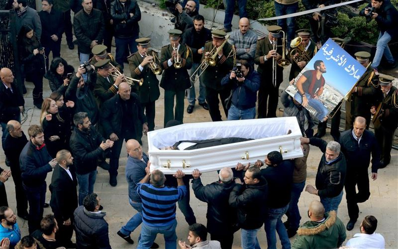 Friends and relatives of Elias Wardini, who was killed in Istanbul, carry his coffin during the funeral in Church of Our Lady in Beirut.