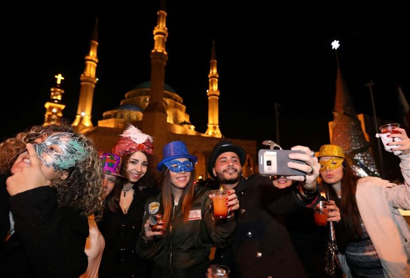 Lebanese celebrate the New Year martyr square near Al-amine mosque in downtown Beirut. (ANWAR AMRO / AFP)