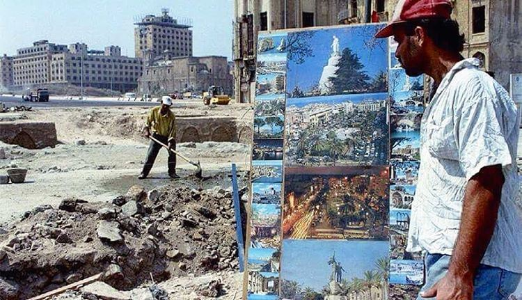 Good morning from #Beirut Martyrs Square , A Lebanese vendor sells posters of pre-civil war central Beirut  Sept. 6, 1994.