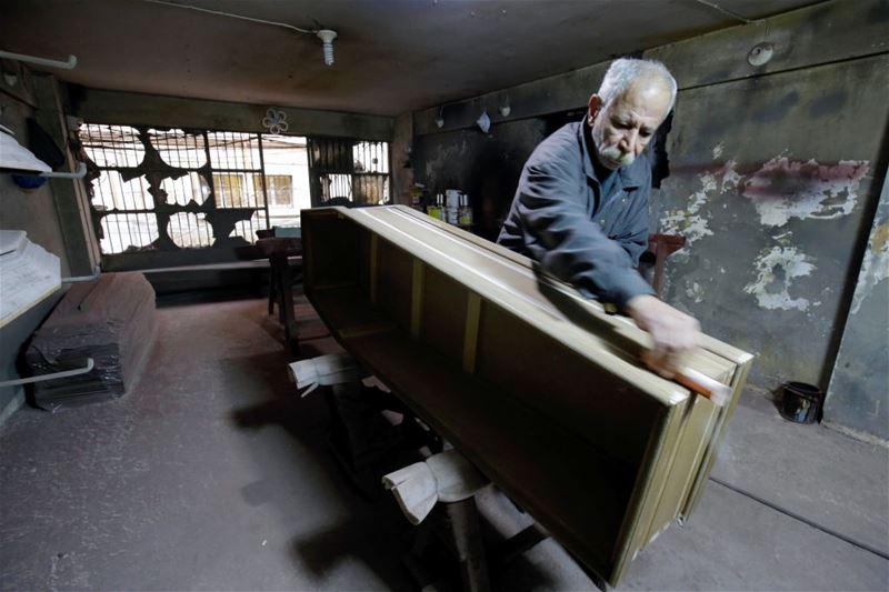 Michel Homsi, the last craftsman building handmade coffins in Tripoli. (IBRAHIM CHALHOUB / AFP)