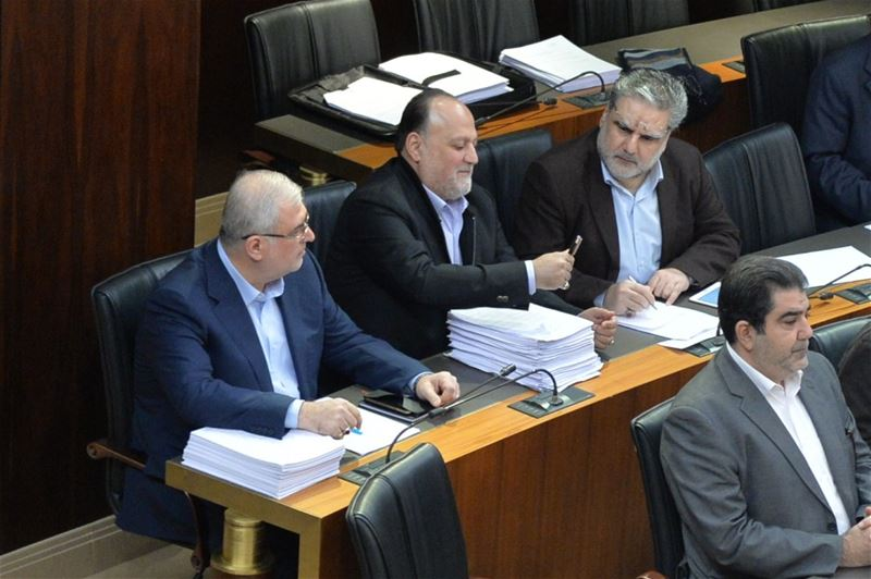 MPs Ali Ammar, Nawaf Mousawi, Mohamad Raad during a legislative session inside the parliament in Beirut. (Hasan Ibrahim / Lebanese Parliament)