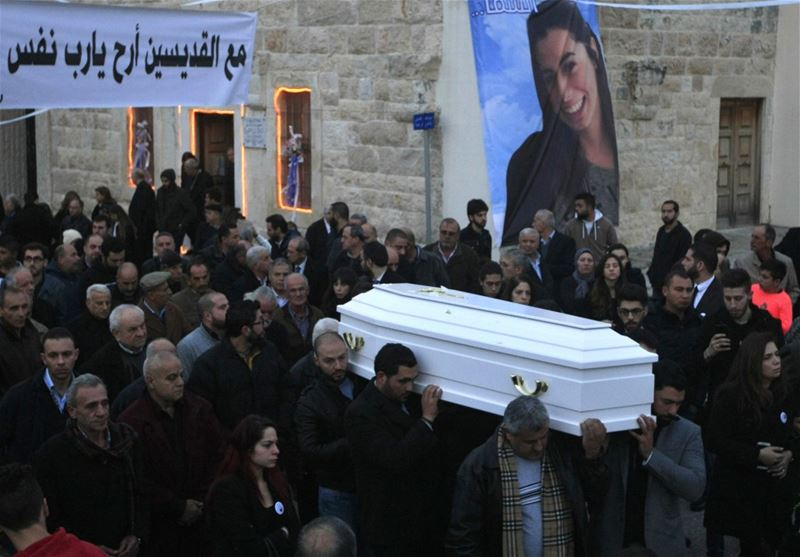 Relatives and friends of Rita al-Shami, who was killed in the New Year's Eve Istanbul attack, carry her coffin during her funeral procession, in Joun.