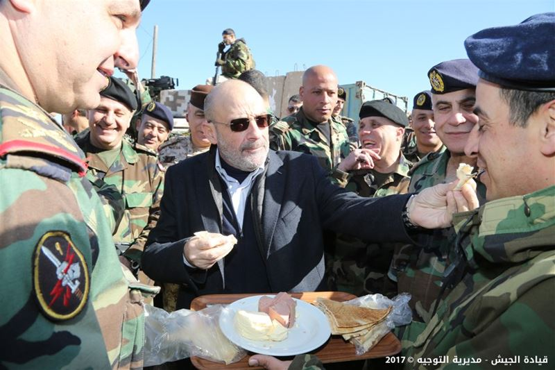 Minister of defence Yaacoub Sarraf feeding a soldier during his today visit to the town of Arsal. (Lebanese army)