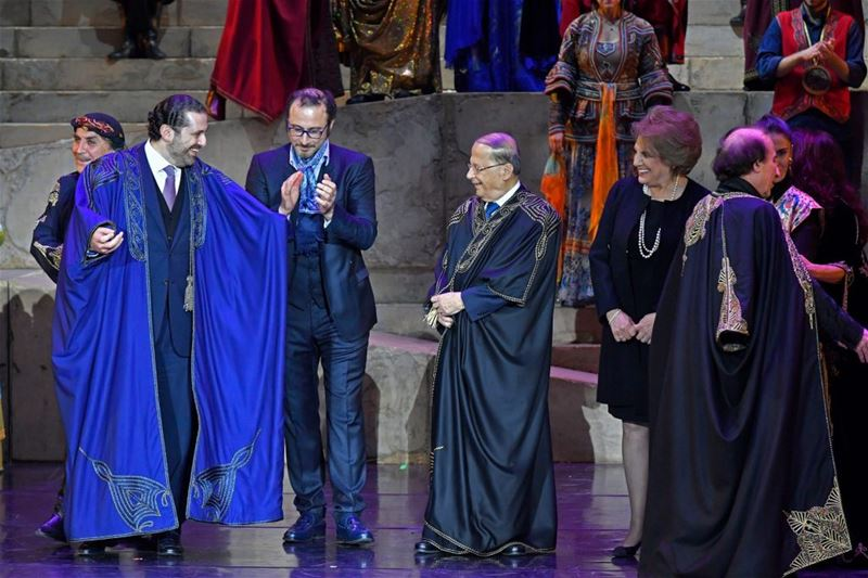 "Caracalla performers giving Michel Aoun and Saad Hariri mantles to wear it during the premiere of ""Sailing the Silk Road"" theater, in Beirut. (Nabil Ismail)"