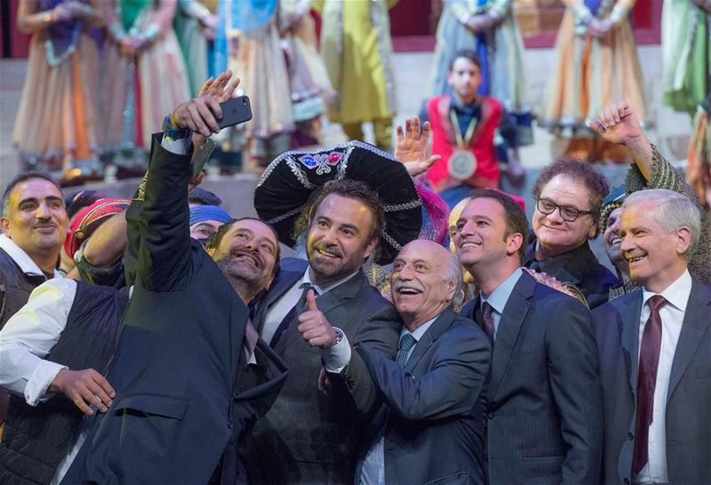 "Saad Hariri snapping a selfie with official representatives in addition to singer Assi Hellani and poet Talal Haydar, during the opening of Caracalla's ""Sailing the Silk Road"". (Nabil Ismail)"