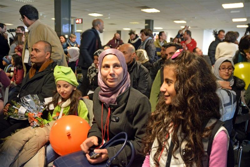 40 Syrian refugees arrive at Fiumicino airport in Italy coming from Beirut thanks to 'humanitarian corridors'. (TELENEWS)  Federica Mogherini (R), EU foreign policy chief, meets with Syrian refugee students in Beirut. (Hasan Shaaban / REUTERS)
