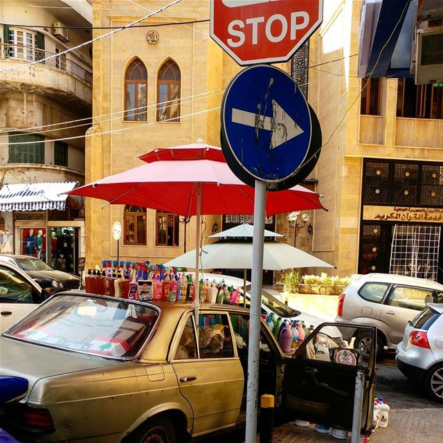 Merchandising on rooftop of an automobile. cleaningsupplies car beirut ... (الجمعية الوطنية الاسلامية)