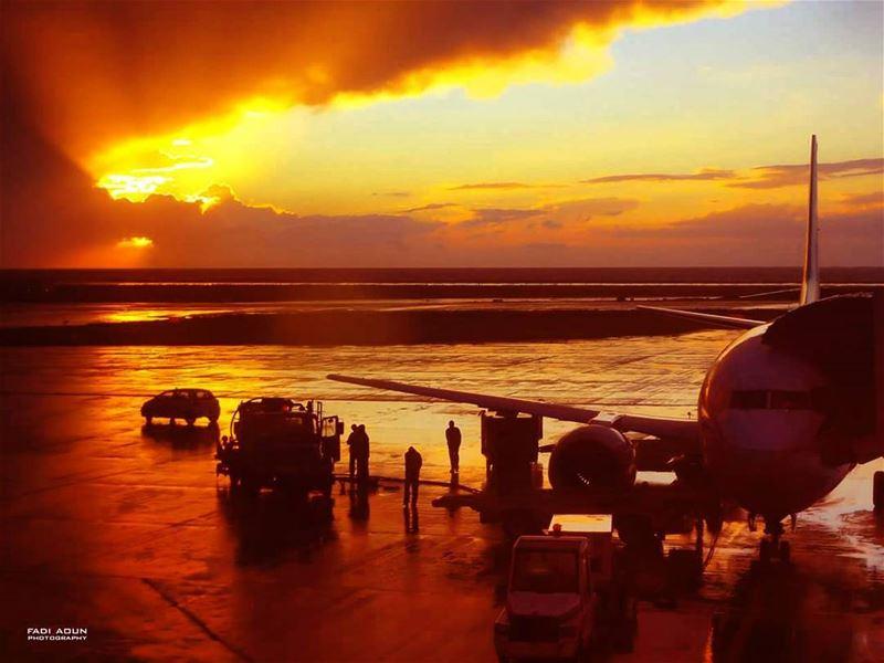 photo fadiaoun @faaoun sunset reflection rain beirut airport ...