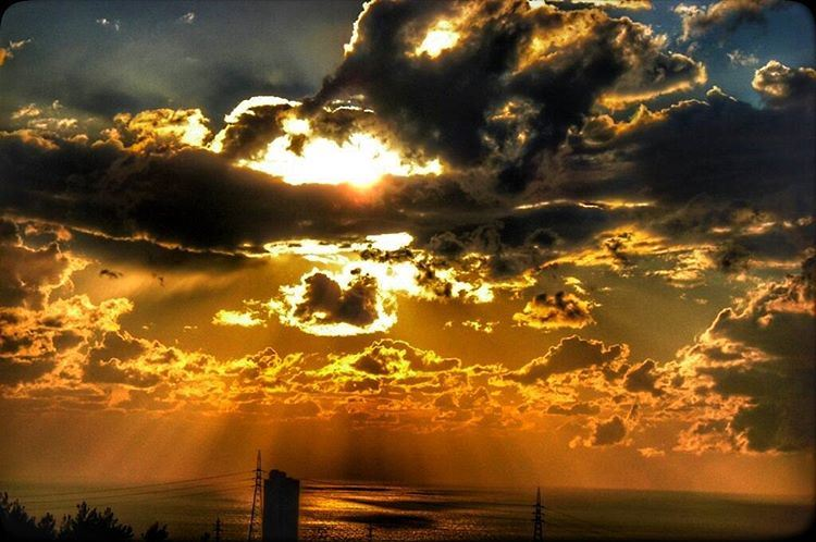 sunset beach cloudy sunrays eclipse amber endofstorm view skyline... (Khalde - Beirut)