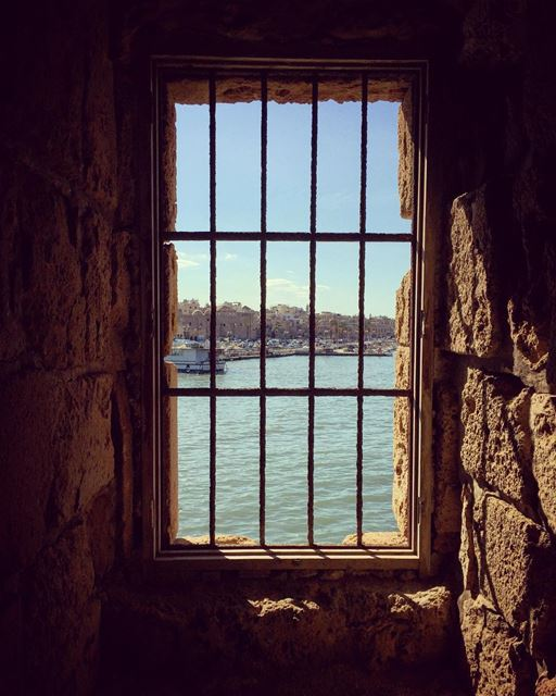 Trapped•••••••••••••••••• ruins bars window sea port boats fish ... (Sidon Sea Castle)