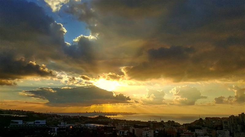 Caption while driving  sunset jounieh clouds blue sky lebanon water...