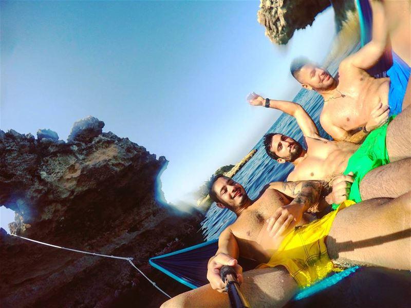 summer sunday friends hammock blue yellow green beach ocean cliff...