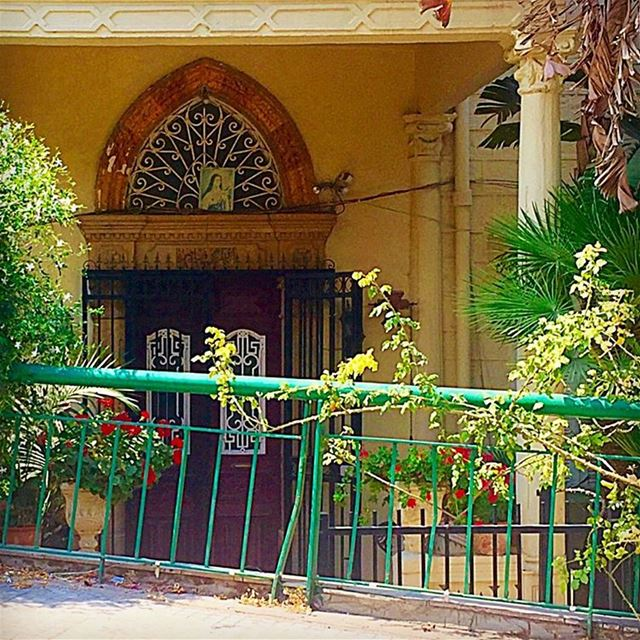 And tucked inside...was a burgundy door door arch greenrails entrance ... (Beirut, Lebanon)