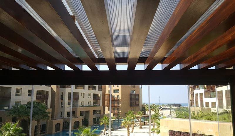 pergola iroko wood curtainglass polycarbonate shade design lebanon... (Kempinski Summerland Hotel & Resort Beirut)