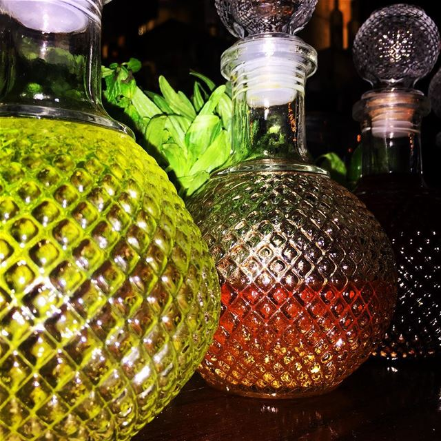 bottles alcoholic drinks light pub green yellow red livelovelebanon ... (Eden Cocktail Bar)
