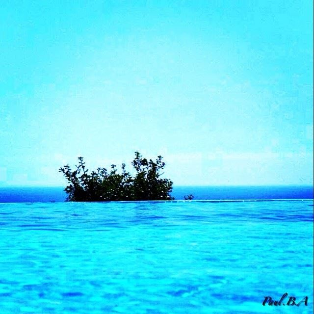 deep blue sea sky pool water nature green tree view Lebanon...