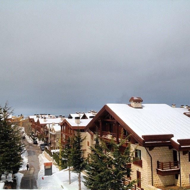 Mzar intercontinental mountain snow chalets cloudy sky Kfardebian...
