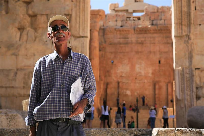 This tour guide provides assistance, information and culture, history and... (Baalbek , Roman Temple , Lebanon)