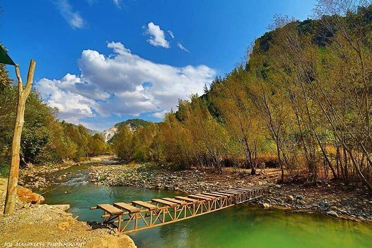 There is always a Way... river sky clouds trees nature water bridge... (Qartaba)