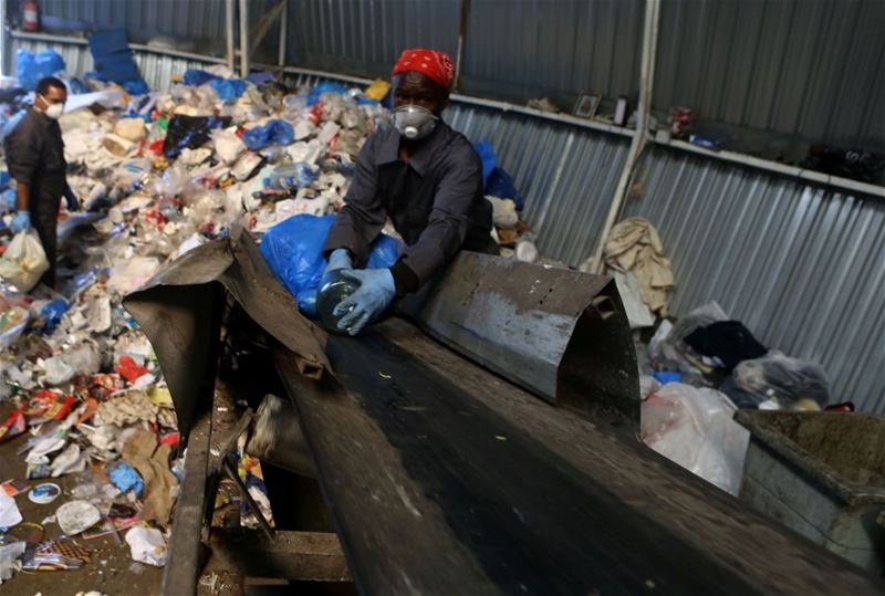 Migrant labourers work at a waste recycling plant in Bikfaiya.