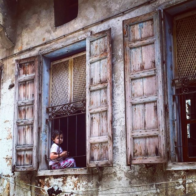 The old is home to raised memories and opened windows to external world.... (Tripoli - The Old City)