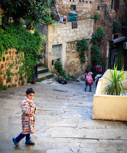 Keep warm 🌥 cold morning cloudy kid boy cozy street old warm ... (Tripoli, Lebanon)