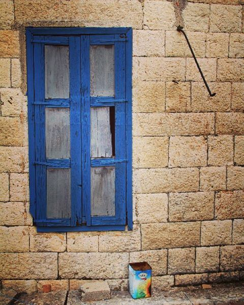 Courtesy of a street. window street village mountain house home ... (Douma Souks)