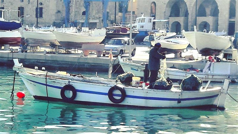 A local fisherman prepares his net at Batroun's port ⛵No pain, no... (Batroûn)