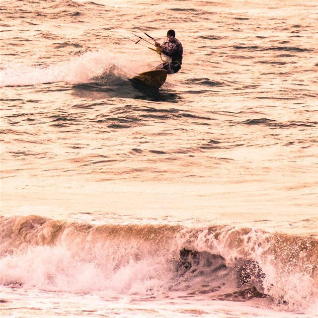 Riding the waves on a very cold day! The adrenaline steals the cold away... (Laguava Resort Rmeileh)