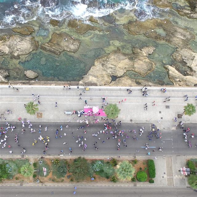 Live above the Lebanese Breast Cancer Foundation stand as the runners pass... (Beirut Marathon)