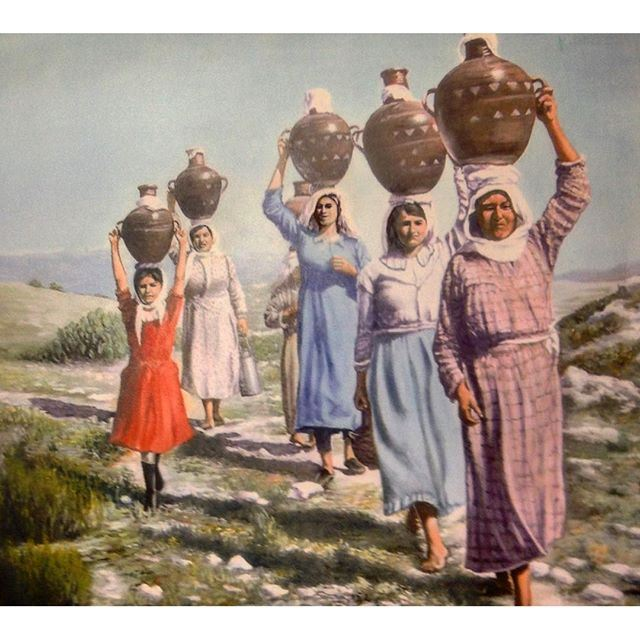 Merouaniyeh SouthLebanon Women with their water filled jar .