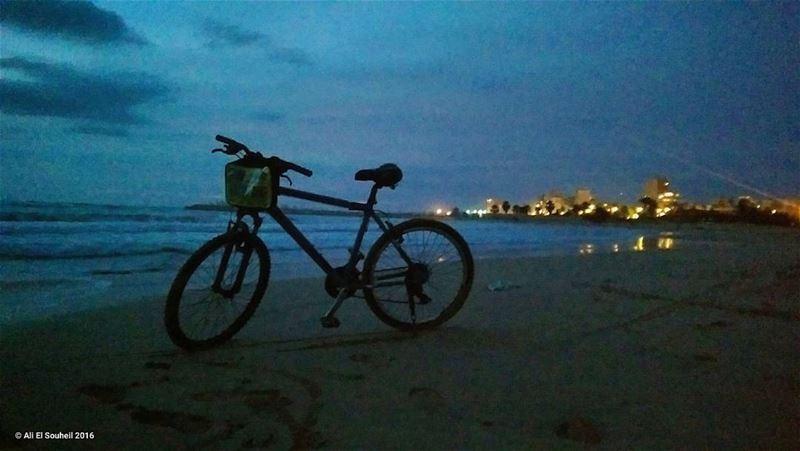 tb bike sour beach sunset night sea biking lights ... (Tyre-Beach)