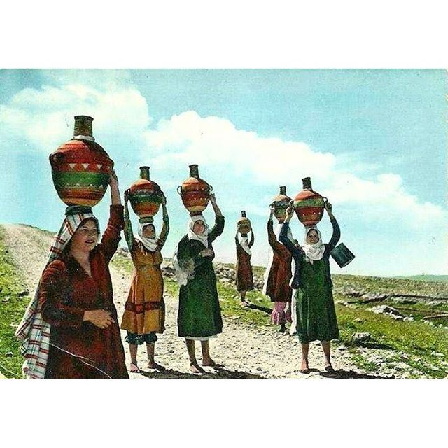 Good Morning From Bekaa - 1945 , Women with their water filled jar .